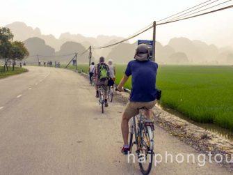 Biking to village in Tam Coc