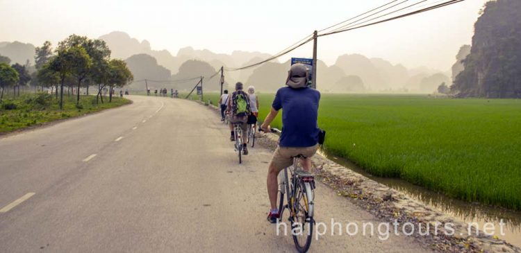 Biking to village in Tam Coc