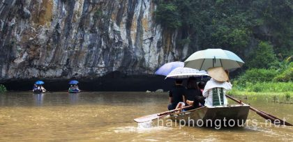 boating through cave in Tam Coc