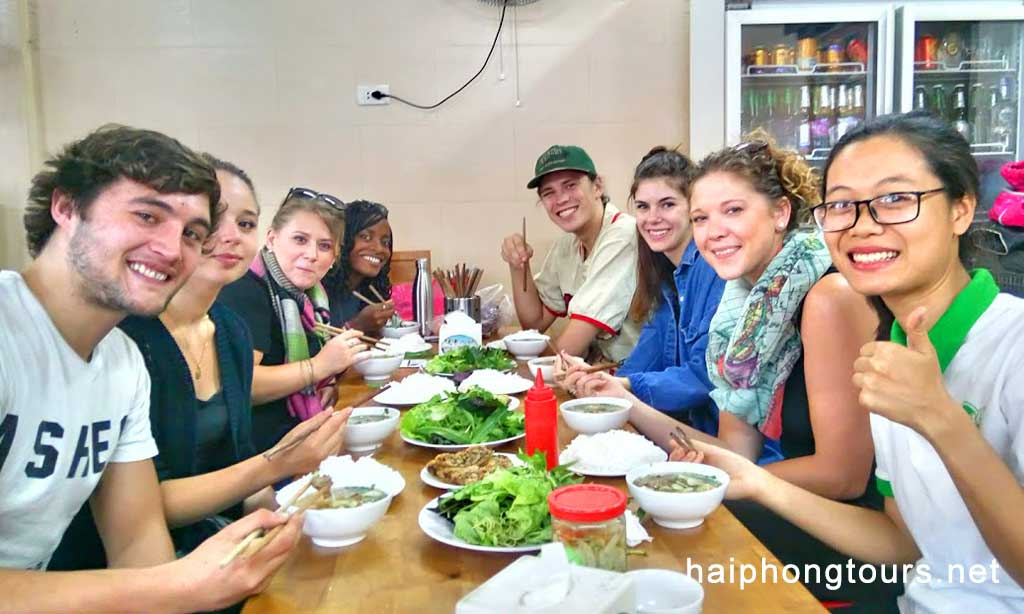 Enjoying Pho with guide Hanoi street food tour